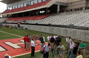 WKU Associate Athletics Director Craig Biggs (fourth from left) gives a tour of the new Houchens Industries-L.T. Smith Stadium during Media Day on Tuesday. The Toppers open the 2008 season Aug. 30 at Indiana.