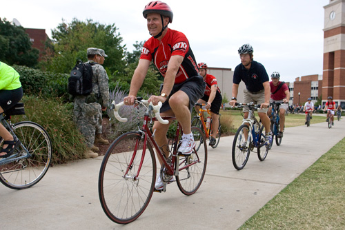 WKU President Gary Ransdell leads a bike ride from Guthrie Tower to Fountain Square Park.