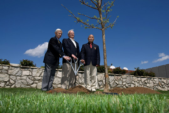 Dan Cherry, Lowell Guthrie and Nguyen Hong My participated in a tree planting April 20 near the Guthrie Tower on WKU's campus. The ceremony honored the friendship of Cherry and Hong My. (WKU Photo by Clinton Lewis)