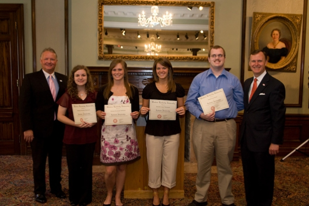 The 2009 recipients of the National City PNC Harman and Potter Incentive Scholarships were honored May 12 at WKU's Kentucky Building. From left are Marvin Stratton, community president for National City PNC; Brooke Schreiner of Greenwood High; Savannah Williams of Warren East High; Jennifer Thomason of Bowling Green High; Dan Hood of Warren Central High; and WKU President Gary Ransdell. (WKU Photo by Clinton Lewis)
