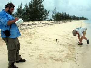 WKU Geography and Geology faculty member Dr. Lee J. Florea (right) collects a GPS location of the coastline of San Salvador Island, Bahamas, while WKU Geoscience graduate student Scot Russell (left) records data. (Photo by Chasity Stinson)