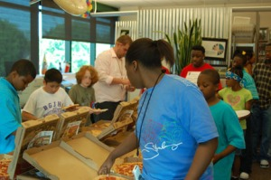 Kaleidoscope students gather around to enjoy the pizza party before taking part in the Imagewest creative workshop.