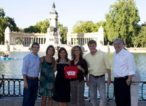 The Imagewest International team raises the red towel with pride at Retiro Park in Madrid.