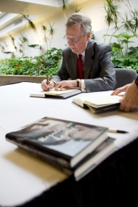 "Following his presentation, Sen. McConnell signed copies of John David Dyche's ""Republican Leader: Political Biography of Senator Mitch McConnell."" (WKU photo by Clinton Lewis)"