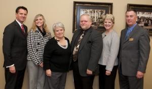 Western Kentucky University and South Central Bank of Glasgow honored a student from Caverna High School on Wednesday. From left are: Dr. Dean Kahler, WKU's Associate Vice President for Enrollment Management; student Dylan Denison, principal Debbie Lindsey, superintendent Sam Dick, guidance counselor Jane Edwards, South Central Bank representative Brad Manship. (WKU photo by Clinton Lewis)