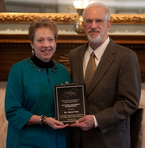 Dr. Gene Tice (right), director of WKU's Owensboro campus, received the Lifetime Honorary Member Award from the SACSA. Making the presentation during a luncheon Jan. 6 at the Kentucky Museum was Dr. Sherryl Byrd, Vice President for Student Affairs at Austin Peay State University and a past president of SACSA. (WKU photo by Clinton Lewis)