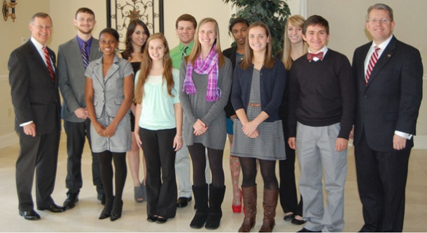 WKU honored 10 students from Lexington. From left: WKU President Gary Ransdell, Zachary Young, Cecile Avery, Kierra Muhammed, Brent Harney, Lisa Laufenberger, Vynique Walker, Anna Durham, Karis Allan, Courtney Cruse, Jonathan Kinnicutt and Dr. Craig Cobane, executive director of Honors College at WKU.