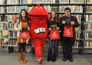 Three WKU students received undergraduate library research awards on Dec. 7. From left: Polly Cowan, Big Red, Chelsea Pitts and Steven Fioretti.