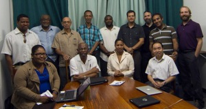 Participants in a meeting hosted by the Caribbean Community Climate Change Centre included: Chalsay Gill, Dr. Kenrick Leslie, Kendra Clarke, Dr. Xingang Fan; Back (L-R) Ronald Gordon, Dr. Ulric Trotz, Carlos Fuller, Abel Cenfella, Harrison Cooper, Timo Baur, Dr. Jason Polk, Arnoldo Bezanilla and Dr. Josh Durkee