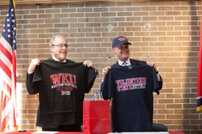 Vol State President Jerry Faulkner (left) and WKU President Gary Ransdell exchanged gifts after signing a dual admissions agreement on Feb. 14 at the Vol State campus in Gallatin, Tenn. (WKU photo by Clinton Lewis)