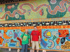 Dr. Jane Olmsted and student Chad Green in front of a mural in the Plaza de Armas in Iquitos, Peru.