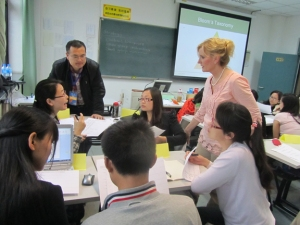 Dr. Lisa Murley works with a group of teachers in China.