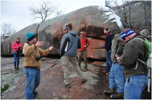 Hoffman Institute staff member Benjamin Miller (second from left) explains how the Elephant Rocks formed millions of years ago to WKU students (from left) Michelle Foley, Adam Aldridge, Brent Eberhard, Brian Ahlers, Paul Shively and Ben Rafferty.