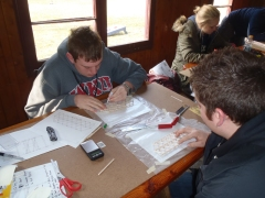 WKU students Blake Adams (foreground) and Raymond Van Zee work on their regional champion balsa wood bridge.