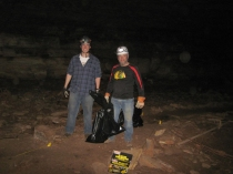 Kegan McClanahan and Phil Goldman filled up bags of trash inside Crumps Cave.
