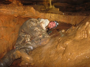 Dan Nedvidek sets up research equipment in a Bowling Green cave.