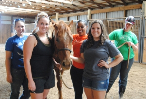 Four WKU students developed a $100 Solution project working with New Beginnings Therapeutic Riding. The students (from left) are Jane Johns of Bowling Green, Olivia Dorris of Bowling Green, Paige Freeman of Louisville, and Kimberly Hampton of Maceo.
