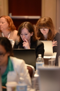 WKU students (from front to back) Lauren Lorance, Brie Logsdon and Anna Anderson work on projects with INMA editor Dawn McMullan (back left) at the meeting in New York City.