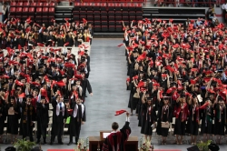 Members of WKU's Class of 2013 waved red towels at the conclusion of the 173rd Commencement ceremonies on May 11 at Diddle Arena. (WKU photo by Clinton Lewis)