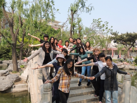 The Hanban Volunteer Chinese Teacher class of 2013 and program instructors posed for a photograph in the gardens at Beijing Language and Culture University.