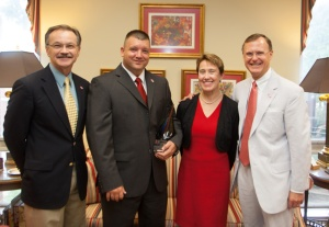 Brad Cannon of Home Instead Senior Care (second from left) received the inaugural Age-friendly Awareness Award. From left are Bowling Green Mayor Bruce Wilkerson,  Cannon, Dr. Dana B. Bradley and WKU President Gary Ransdell.