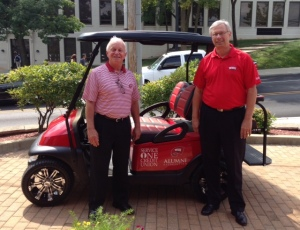 "Service One Credit Union has partnered with the WKU Alumni Association for the ""Big Red Mobile."" From left are Rick DuBose, executive director of the WKU Alumni Association, and Garth Griese, of Service One Credit Union."