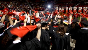 Members of the Class of 2013 waved red towels at the end of the ceremonies. (WKU photo by Bryan Lemon)