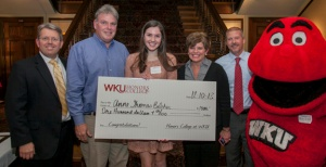 South Warren High School senior Anne Thomas Belcher was one of two Scholar of the Week scholarship recipients. From left: Dr. Craig Cobane, Gerald Belcher, Anne Thomas Belcher, Debbie Belcher, WBKO's Tim Maloney and Big Red. (WKU photo by Bryan Lemon)