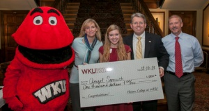 South Warren High School junior Angel Semrick was one of two Scholar of the Week scholarship recipients. From left: Big Red, Stephanie Semrick, Angel Semrick, Dr. Craig Cobane and WBKO's Tim Maloney. (WKU photo by Bryan Lemon)