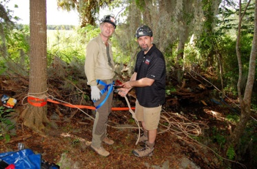 Dr. Jason Polk (right) assisted BBC documentary host Dr. Iain Stewart with a harness to descend into the void below. (Photo by Tom Turner)