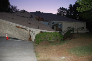 A house falling into a sinkhole in west-central Florida. (Photo by Jason Polk)