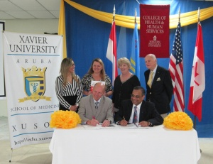 Dr. John Bonaguro, (left) Dean of WKU's College of Health and Human Services, and Ravishankar Bhooplapur, President of Xavier's Aruba Campus, signed an agreement Jan. 27.