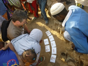 Jonathan Oglesby tests solar disinfection pictograms with the Songhai.