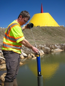 WKU graduate student Dan Nedvidek installs the EXO II sonde by the NCM Skydome.