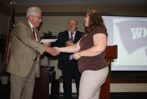U.S. Air Force veteran Teresa Jameson is among  more than 2,500 veterans who have been served by Veterans Upward Bound at WKU since 1992. Above, she received a scholarship from Col. Robert E. Spiller at the 2013 VUB awards banquet. VUB Director Davy Stone is in the background.