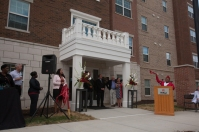 WKU student Quinna Hogan, a senior from Nashville, Tenn., waved a red towel after her remarks at the ceremony. She is a resident at 1355 Kentucky Street Apartments.