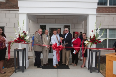 WKU President Gary Ransdell, members of the Student Life Foundation and others cut the ribbon for the new 1355 Kentucky Street Apartments on Aug. 11.