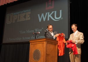 UPIKE President James L. Hurley and WKU President Gary A. Ransdell exchanged gifts after an announcement Aug. 28 in Pikeville. (WKU photo by Bob Skipper)
