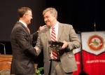 Dr. Bruce Kessler accepted the University Award for Teaching on behalf of Dr. Summer Bateiha.