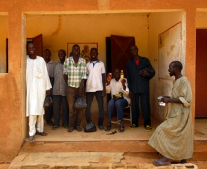 A group of Zerma and Fulani men showed the contents of their care packages they received after conducting eye-tracking trials in the village of Bassi.