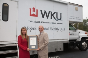 Micaela Skura, Business Project Liaison for Delta Dental of Kentucky, met with Dr. John Bonaguro, Dean of the College of Health and Human Services, to discuss continued partnerships. (WKU photo by Clinton Lewis)
