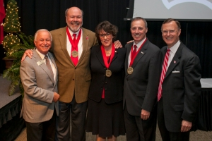 Distinguished Service Medals to recognize the service of the University's top volunteers were presented Nov. 6 at the 2014 Summit Awards. From left: Rick DuBose, executive director of the WKU Alumni Association; Jim Martens, Dr. Linda Johnson Vitale, Craig Browning and WKU President Gary Ransdell. (WKU photo by Bryan Lemon)
