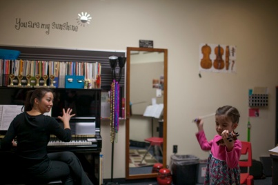 Ching-Yi Lin worked with a student in the Pre-College Strings Program on Feb. 1.