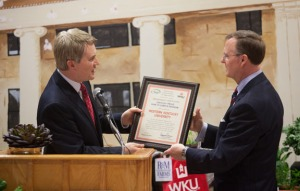 Agriculture Commissioner James Comer (left) presented a certificate noting WKU's induction into the Kentucky Proud Farm to Campus Program to President Gary Ransdell on March 16. (WKU photo by Clinton Lewis)