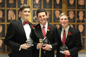 McGavinn Brown (center) was crowned WKU's 2015 Coming Home King on Feb. 28. Taylor Ruby (left) was second runner-up; Matthew Lawson (right) was first runner-up.
