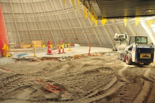 The sinkhole opening that was once in the floor of the Skydome is barely visible as crews work to finish filling in the hole and prepare to lay a new concrete floor that will be supported by micropiles.