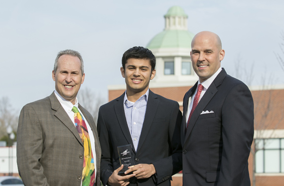 Gatton Academy senior Vir D. Patel (center) poses with Rene Trué of ConnectKentucky (left) and Tom Ferree of Connected Nation after receiving the Secondary Student Technology Award at Tech Day in Kentucky 2015 at the Knicely Conference Center. (Photo by Sam Oldenburg)