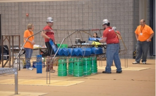 Steel bridge being load tested at the regional competition. From left: Blake Adams and Ben Mullins.