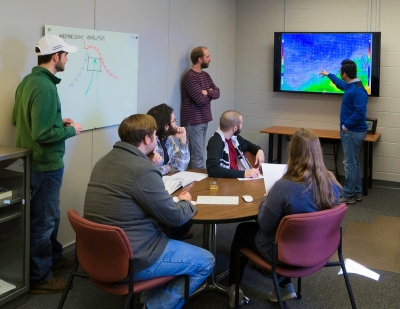 Dr. Josh Durkee and WKU meteorology students at work in the CHAOS (College Heights Atmospheric Observatory for Students) facility.