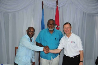From left: Caribbean Community Climate Change Centre Executive Director Dr. Ken Leslie, CCCCC Deputy Director and Scientific Advisor Dr. Ulric Trotz and WKU President Gary Ransdell shake hands after signing a cooperative agreement April 27 in Belize.